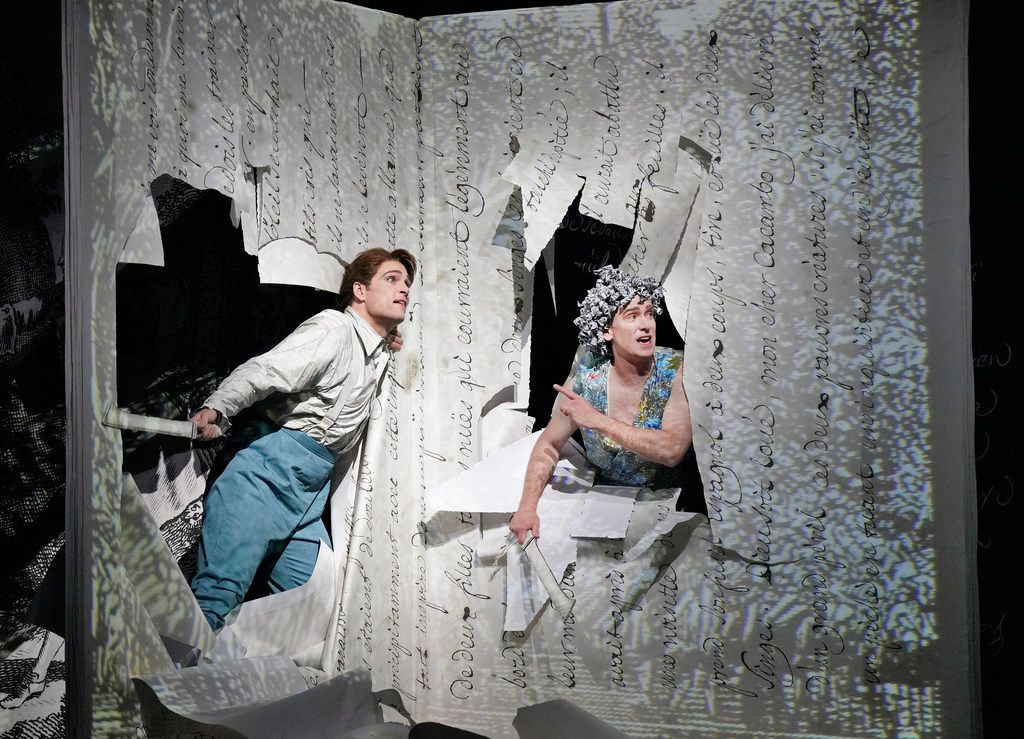 Chantal Thomas' scenery for Candide seems to represent giant sheaves of paper, flat or curling. (Photo by Ken Howard)