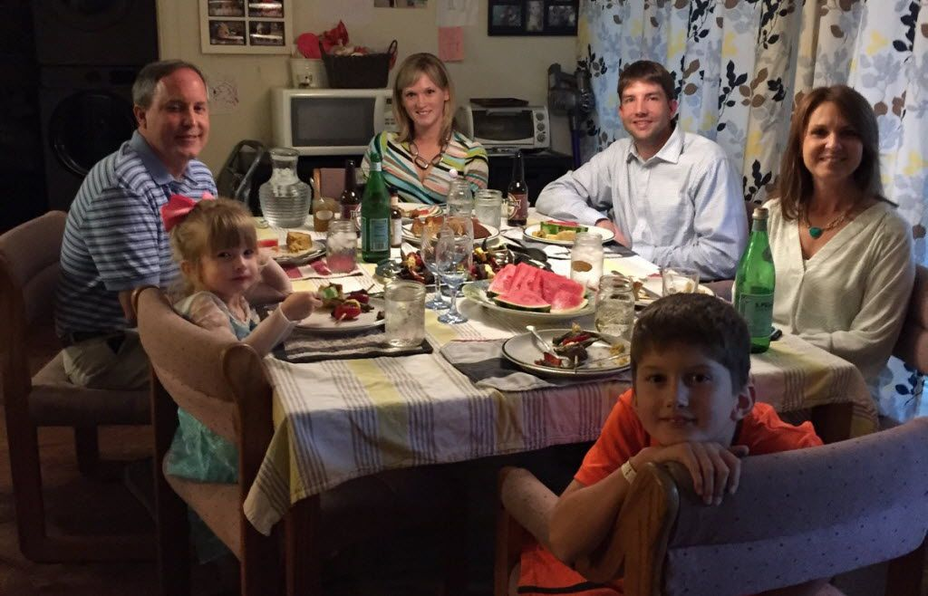 Texas Attorney General Ken Paxton (left)  and his wife, Angela, join the Briggle family — Adam, Amber and their children Lulu (next to Paxton) and MG —  for dinner in Denton.