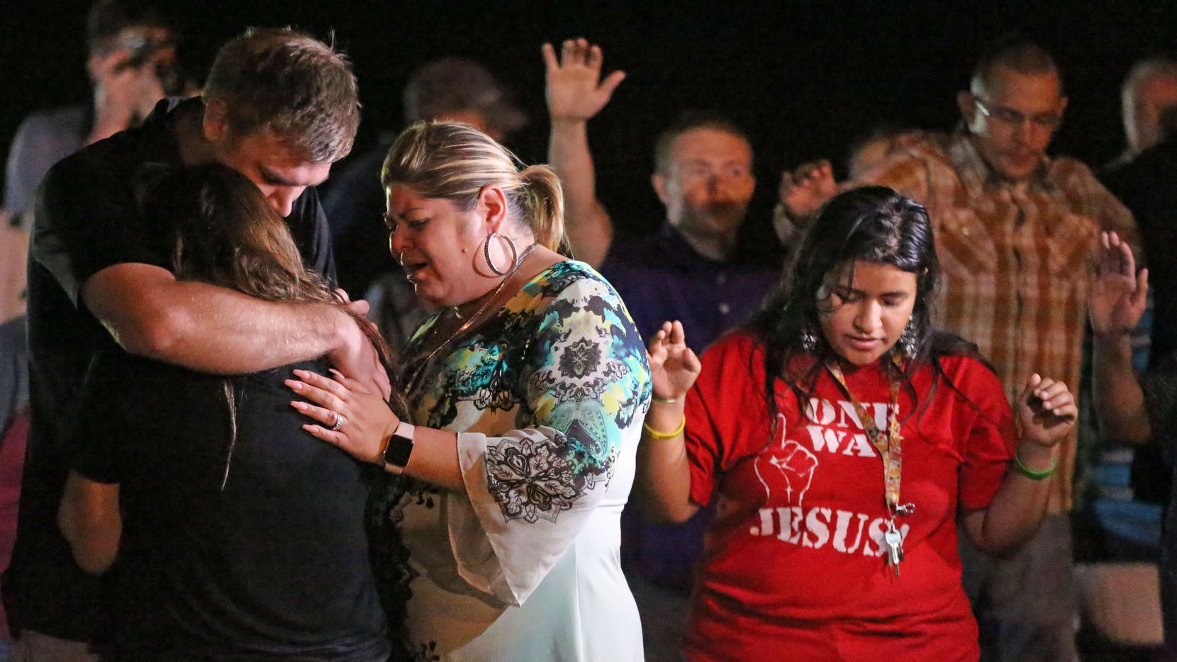 Emotions ran high Monday at a memorial service held at the baseball field in Sutherland Springs to honor those who were killed in Sunday's mass shooting, (Louis DeLuca/Staff Photographer)