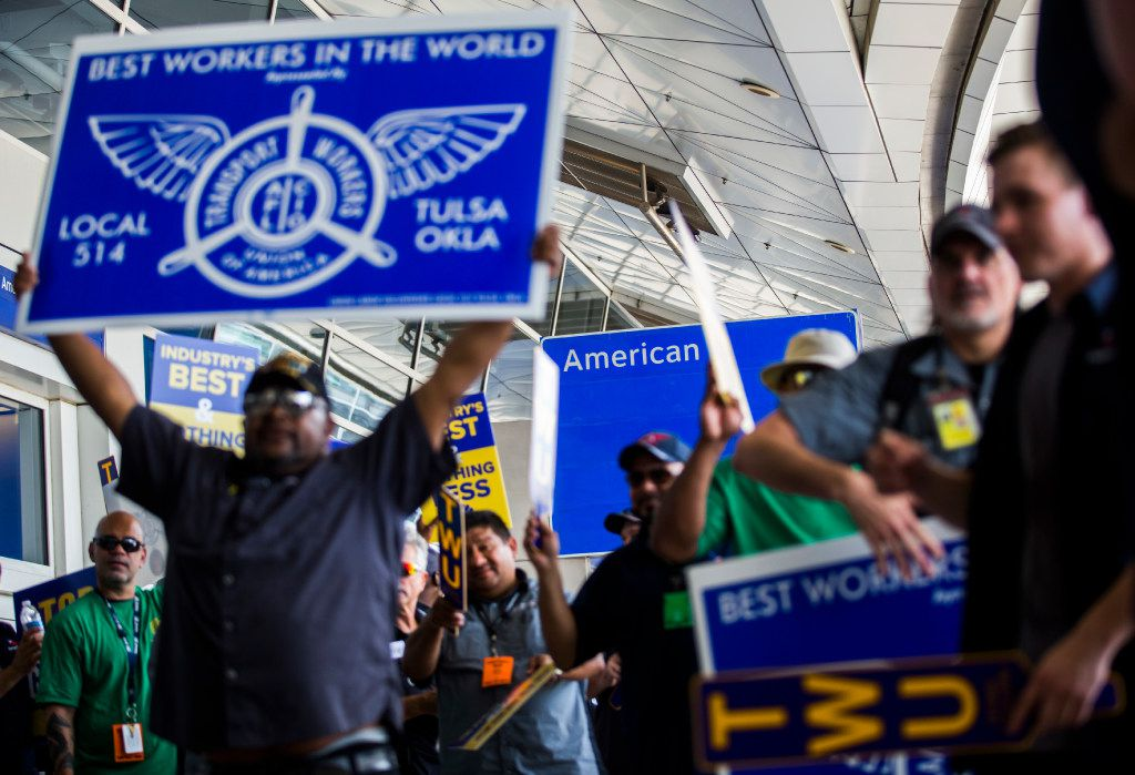 Union workers, such as these American Airlines baggage carriers protesting last year at DFW International Airport, are much more likely to have medical coverage, retirement plans, paid sick days and higher wages.