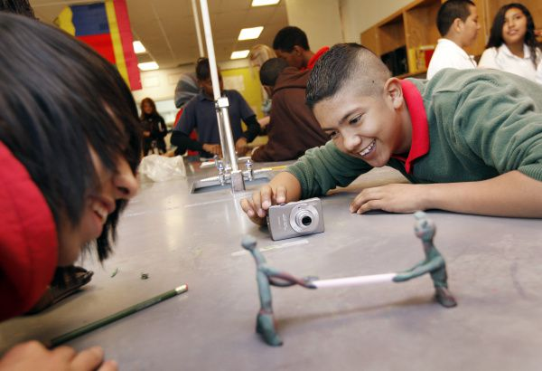 Eighth-graders Jose Obando and Iran Aguirre participate in stop-motion claymation video during their science class at Sam Houston Middle School in Irving.