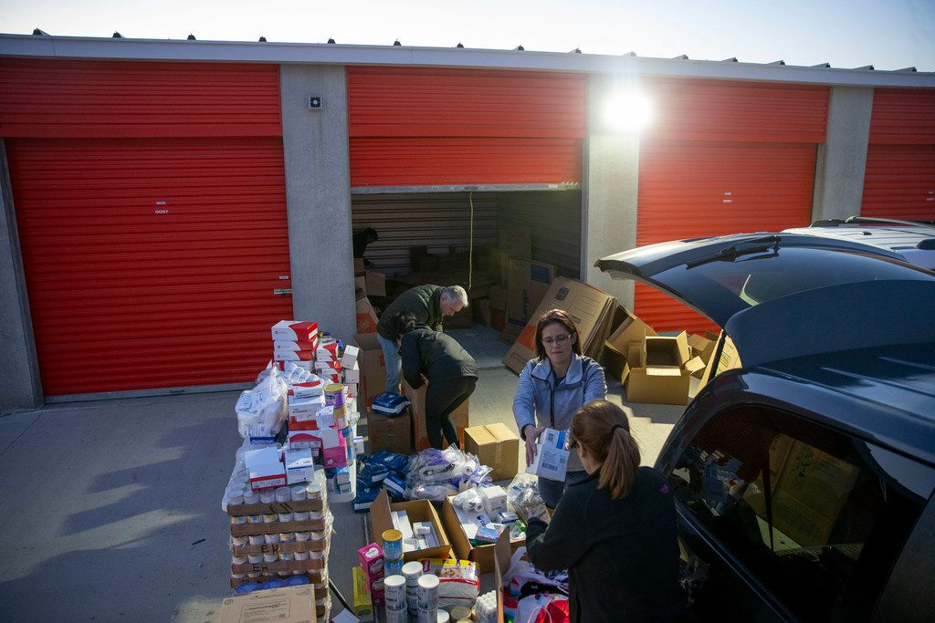 Rebecca Dominguez (center) hands medial supplies to Zeanly Gomez as they pack boxes at a U-Haul storage unit in Prosper, Texas on Wednesday, March 6, 2019. A group of Venezuelans expats gathered to prepare the boxes to be shipped into their home country that is facing shortages of all sorts.