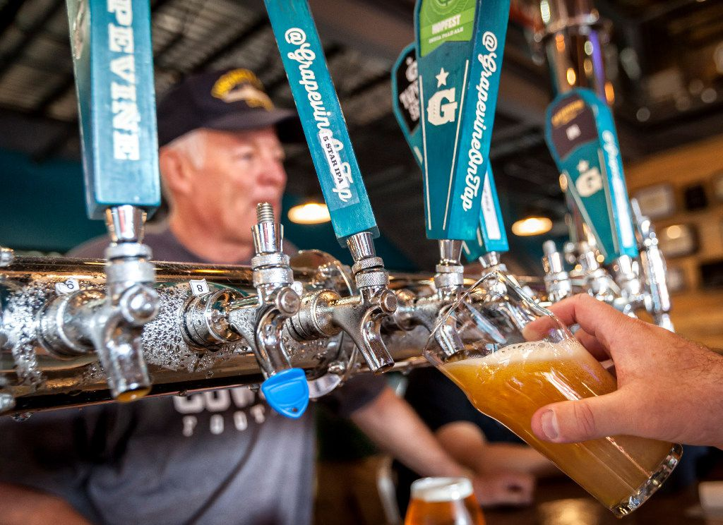 A light beer is drawn from the tap at the Grapevine Craft Brewery in Grapevine, Texas, Saturday, Sept. 9, 2017.