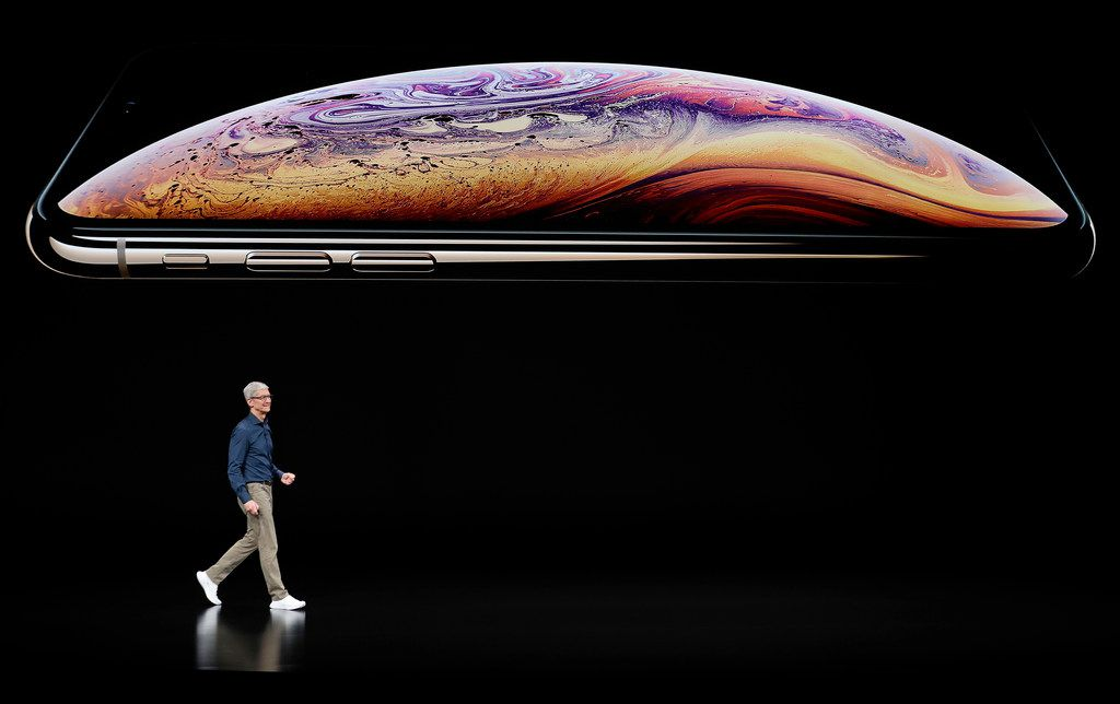 Apple CEO Tim Cook speaks about the Apple iPhone XS at the Steve Jobs Theater during an event to announce new Apple products Wednesday, Sept. 12, 2018, in Cupertino, Calif. (AP Photo/Marcio Jose Sanchez)
