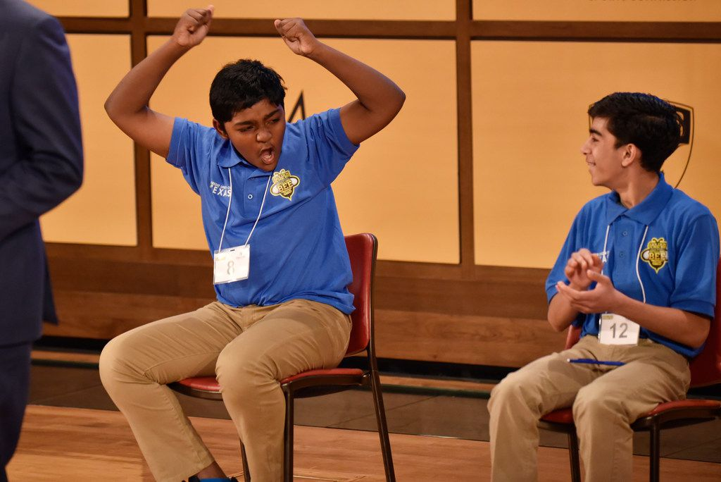 Rohan Raja (left) celebrates after Saturday's regional spelling bee in Dallas after earning a trip to the nation's capital — and applause from fellow competitor Satvik Mahendra.