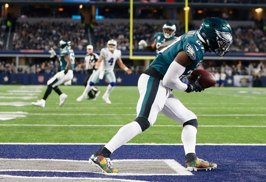 FILE - Philadelphia Eagles strong safety Malcolm Jenkins (27) intercepts a pass from Dallas Cowboys quarterback Dak Prescott (4) during the fourth quarter of play at AT&T Stadium in Arlington, Texas on Sunday, November 19, 2017. (Vernon Bryant/The Dallas Morning News)