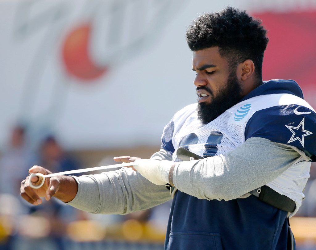 Dallas Cowboys running back Ezekiel Elliott (21) wraps his hand before the start of practice at training camp in Oxnard, California on Thursday, July 27, 2017. (Vernon Bryant/The Dallas Morning News)