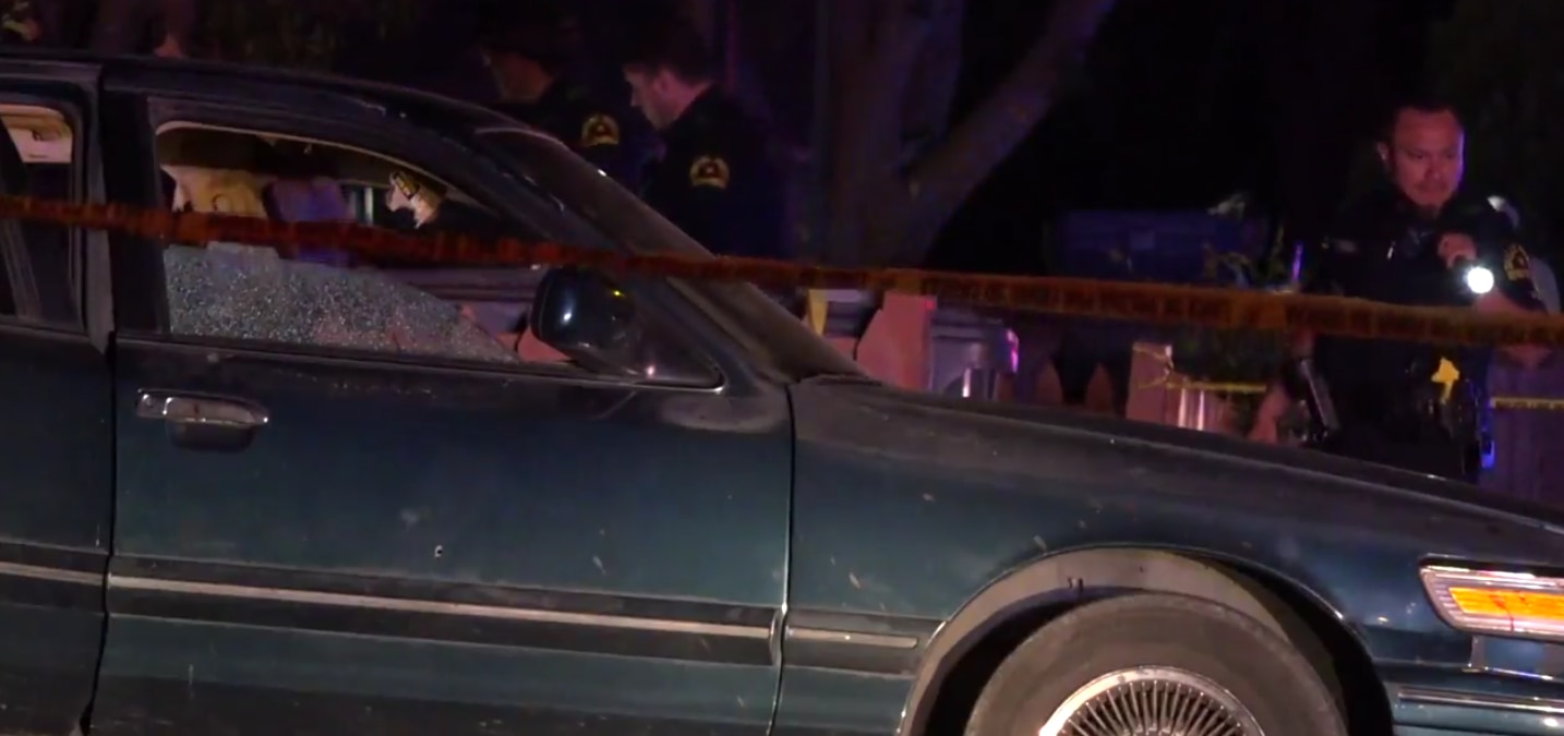 The victims were found lying beside a green Mercury Grand Marquis that was also sprayed with gunfire.