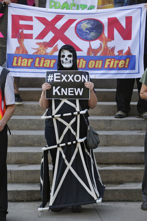 Shannon Carter wears a skeleton mask while dressed as an oil rig as protesters gather outside of the Exxon shareholders meeting.  (Nathan Hunsinger/The Dallas Morning News)