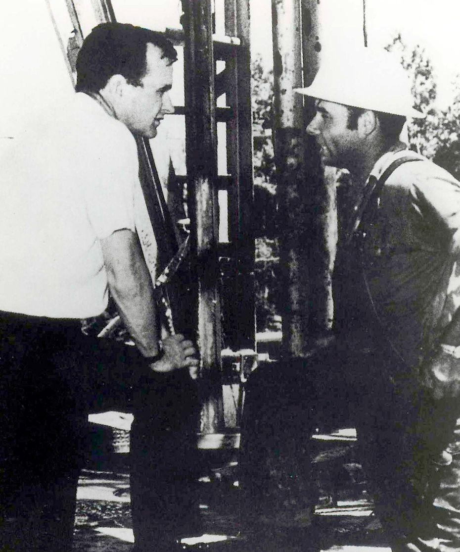 Bush speaks with an oil field worker.