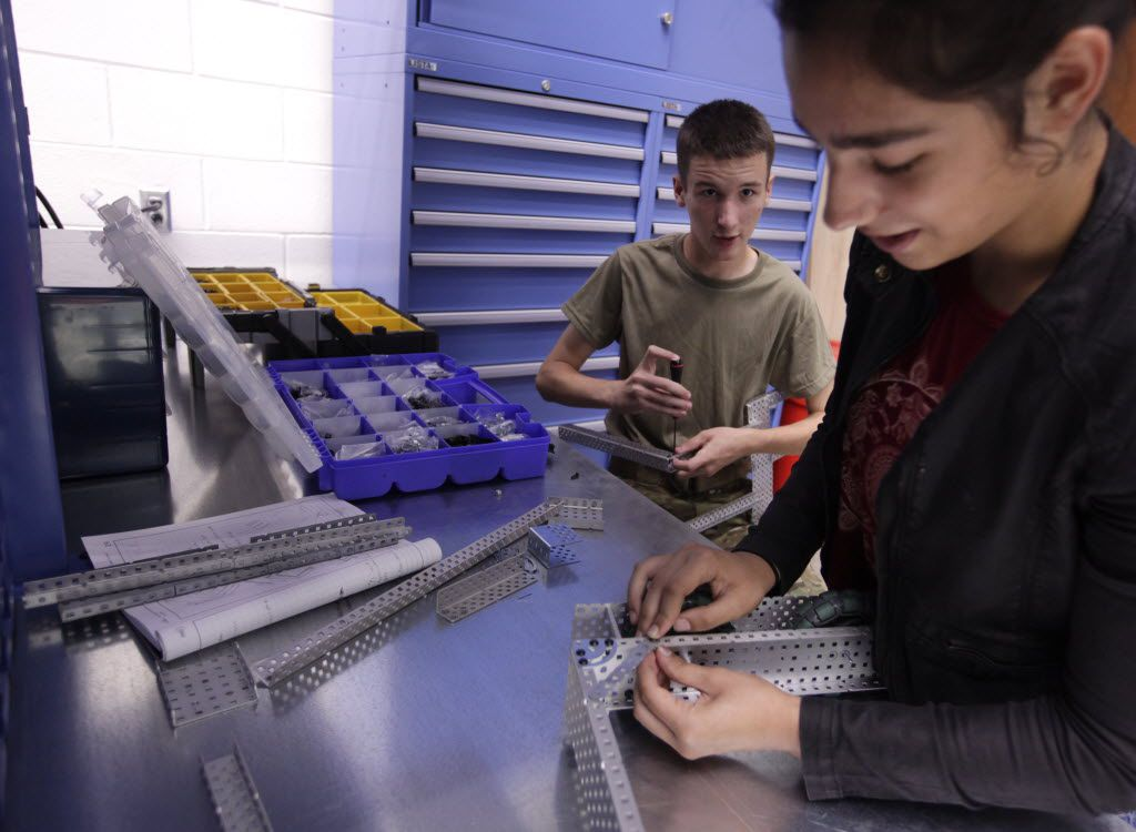 Alex Ferko, 14 years old, left, and Alexandria LeFort, 13 years old, work on a project in a robotics class at Lovejoy High School in Lucas, TX, on Aug. 31, 2016. (Jason Janik/Special Contributor)