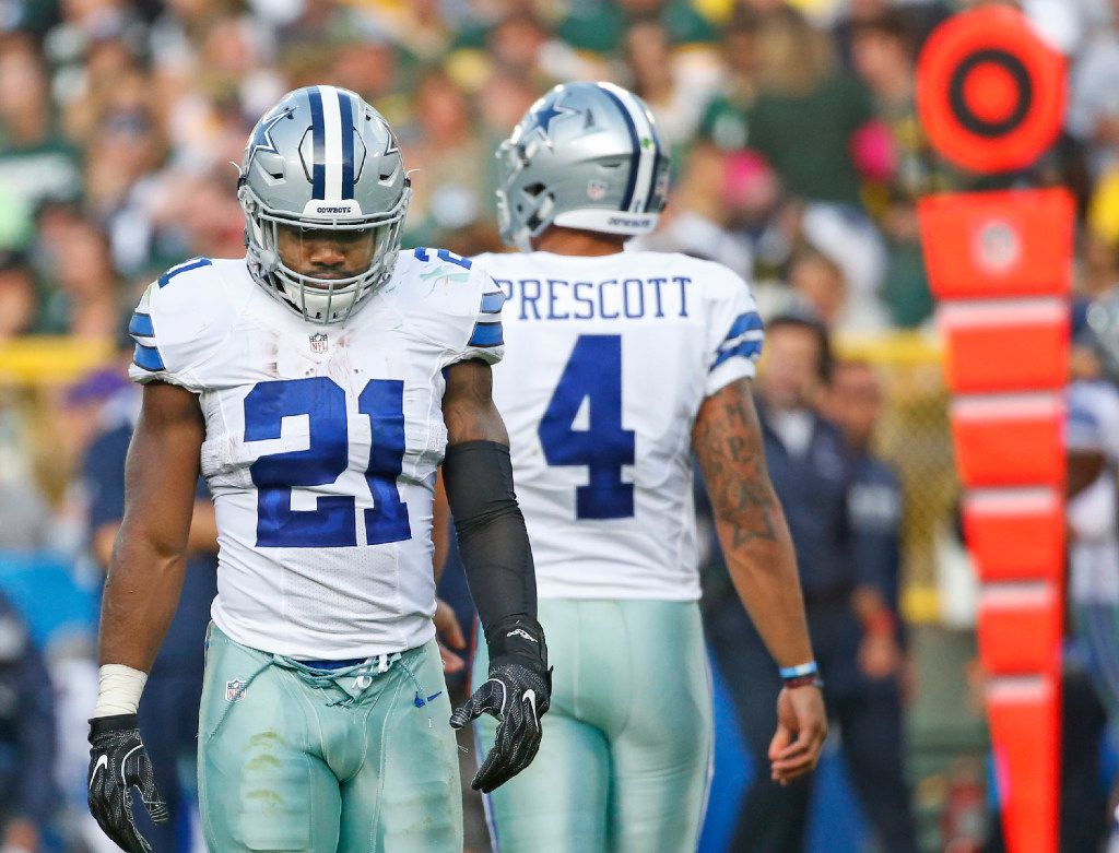 The Dallas 214 area code is represented by running back Ezekiel Elliott (21) and quarterback Dak Prescott (4) during the Dallas Cowboys vs. the Green Bay Packers NFL football game at Lambeau Field in Green Bay, Wisconsin, on Sunday, October 16, 2016. (Louis DeLuca/The Dallas Morning News)
