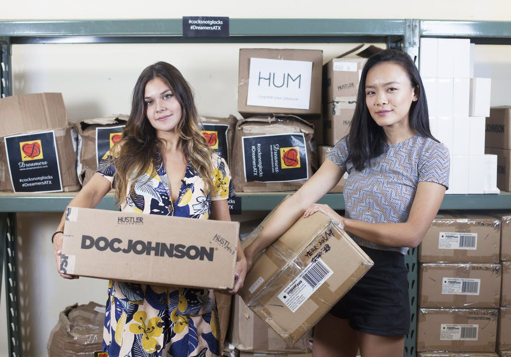 Ana Lopez (left) and Jessica Jin hold boxes filled with sex toys that will be used on Wednesday to protest against the state's new campus carry law. Dreamer's, a Texas-based sex shop, donated and agreed to warehouse thousands of sex toys for the students at the University of Texas who planned the protest.