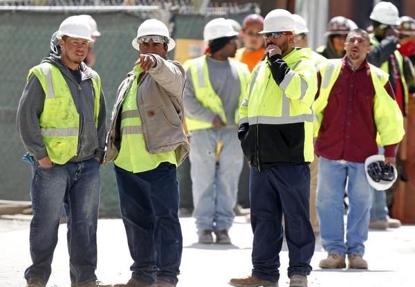 Construction workers watched where a gunman held police at bay.