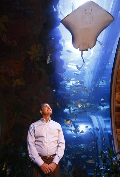 Greg Barron poses looks up at the giant aquarium that welcomes worshipers at Inspiring Body of Christ Church in Dallas.
