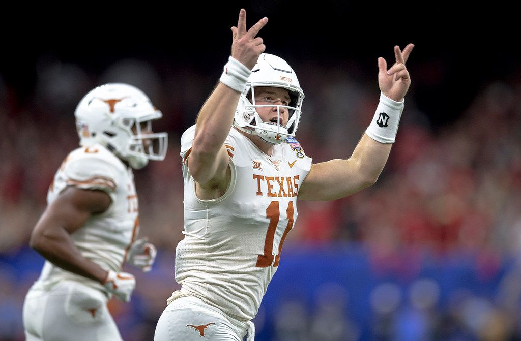 Texas quarterback Sam Ehlinger (11) celebrates one of his touchdowns against Georgia during the first half of the Sugar Bowl NCAA college football game Tuesday, Jan. 1, 2019, in New Orleans. (Nick Wagner/Austin American-Statesman via AP)
