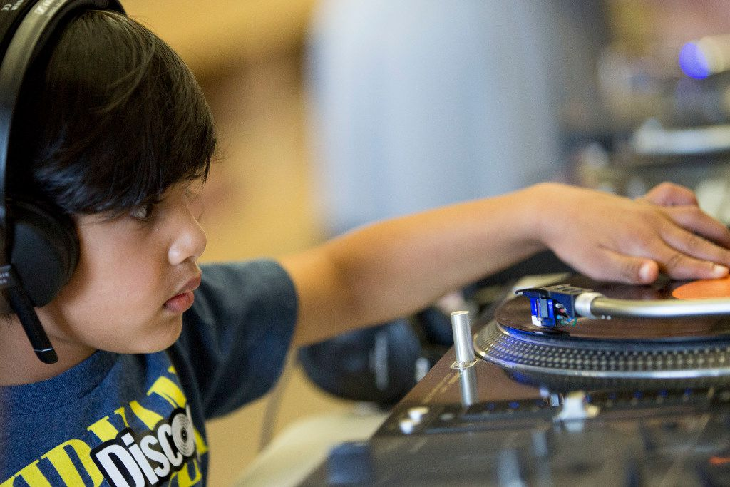 Jayden Shroff, 3, of Plano, tries out a turntable during Kids Dig, a day of record digging and vinyl education at Josey Records on Oct. 29, 2016, in Dallas.