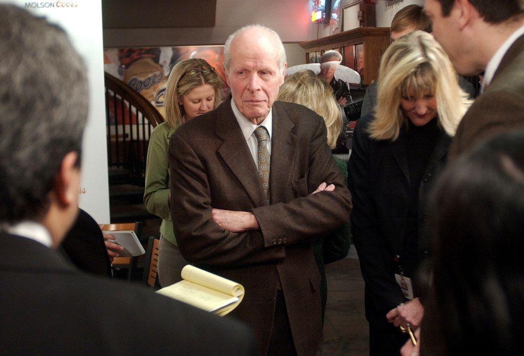 """William """"Bill"""" Coors, center, talks about the merger between Molson and Coors after a news conference at the Coors Brewery in Golden, Colo. Molson Coors Brewing Co. said that William """"Bill"""" Coors, the former chairman of Adolph Coors Co. and grandson of the brewing company's founder, died Saturday at age 102."""