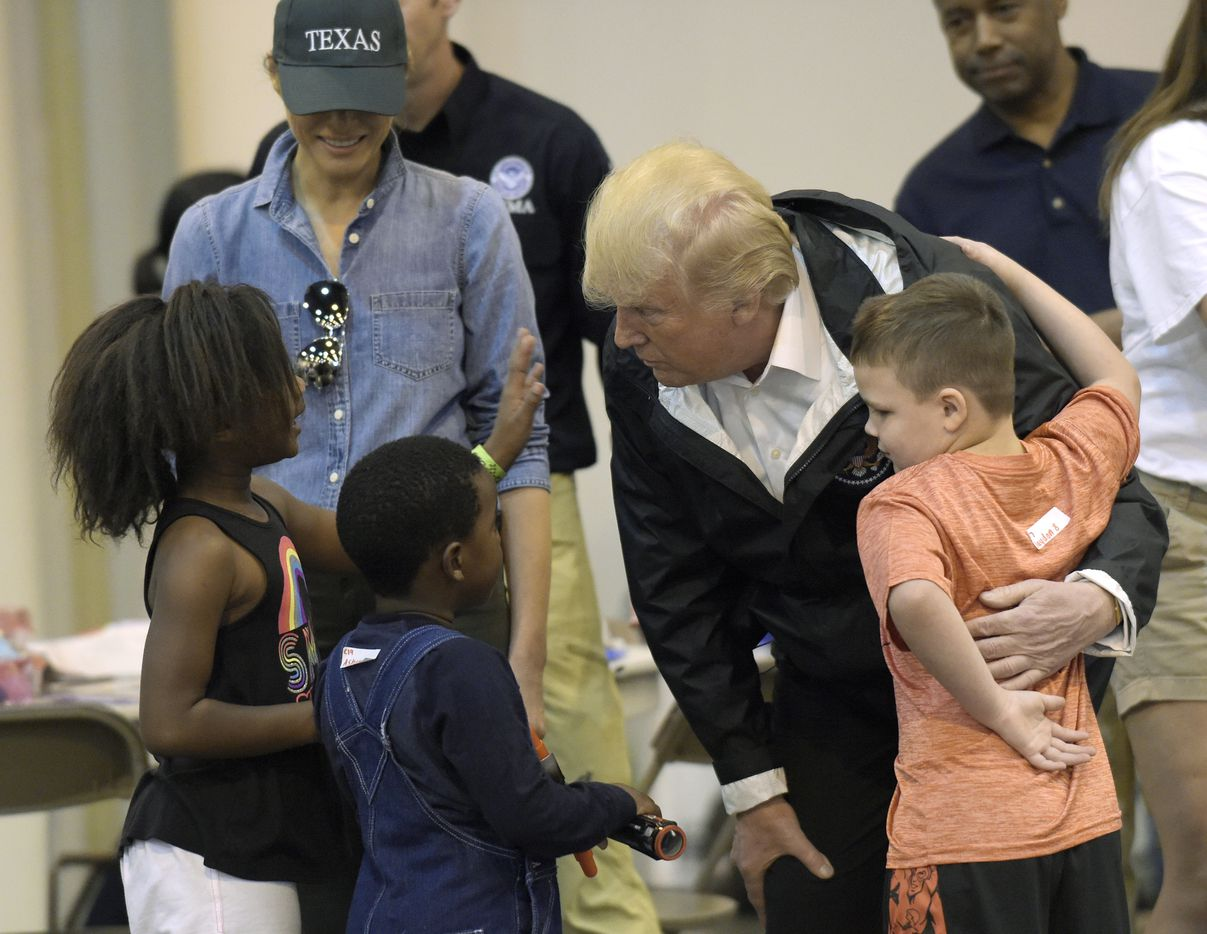 President Donald Trump and his wife, Melania, meet people affected by Hurricane Harvey on Saturday during a visit to the NRG Center in Houston. It was his second trip to Texas in a week, and this time his first order of business was to meet with those barred from their homes by the record-setting rainfall and flooding.