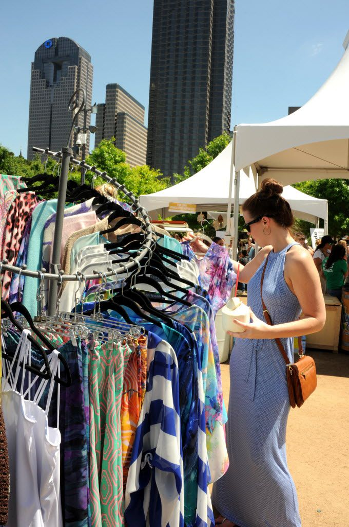 In the West Village neighborhood at Kwestival in Klyde Warren Park in Dallas on April 23, 2016, Allison Stewart shops for summer tops at Abi Ferrin. (Alexandra Olivia/ Special Contributor)