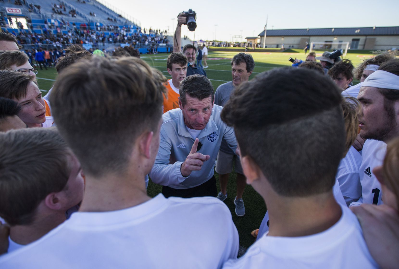 Flower Mound head coach David Doyle talks to his team after a 3-2 win in a UIL conference 6A boys state semifinal soccer game between Flower Mound High School and Alief Elsik High School on Friday, April 19, 2019 at Birkelbach Field in Georgetown, Texas. Flower Mound will advance to the state final on Saturday. (Ashley Landis/The Dallas Morning News)