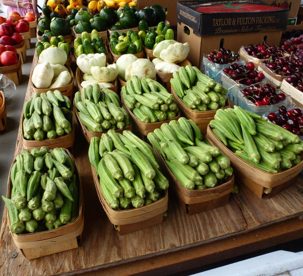 At the outdoor Grapevine Farmers Market, local produce, such as okra and one-ball squash, share the table with West Coast cherries.