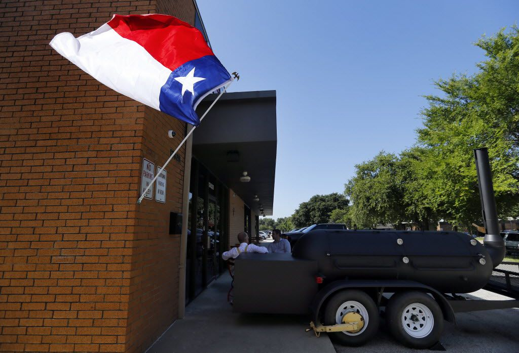 The Texas flag flies outside owners Todd and Misty David's newly reopened Cattleack Barbeque, Wednesday, July 7, 2016, after doubling the size of their location at 13628 Gamma Rd. in North Dallas.
