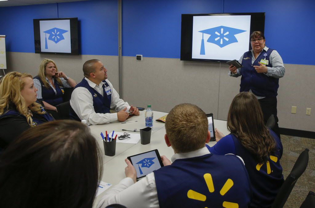 Pierette Rivera, standing far right, a training facilitator at Wal-mart Academy, worked with department managers in a run through for a Walmart Academy at a store in Carrollton. Walmart is opening 200 training academies in its stores to create a better customer experience.