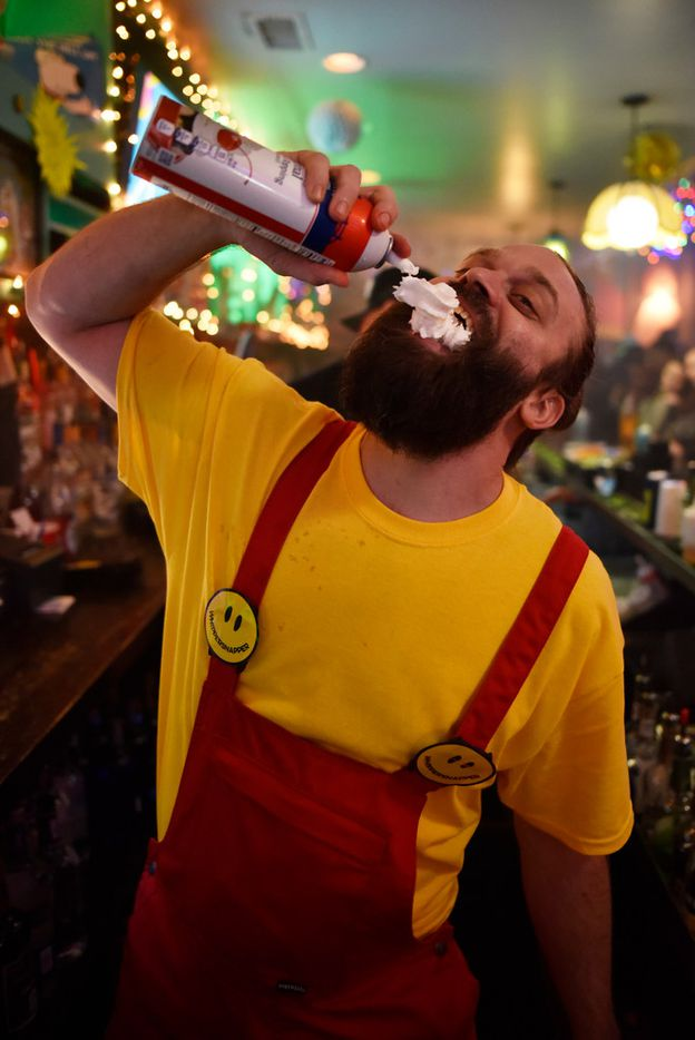 Bartender Chase Fieber jugs a can of whip cream while working the bar inside the pop-up bar the Drunken Clam, Thursday night Jan. 10, 2019 in Dallas. Drunken Clam is themed after the bar in Family Guy. Ben Torres/Special Contributor