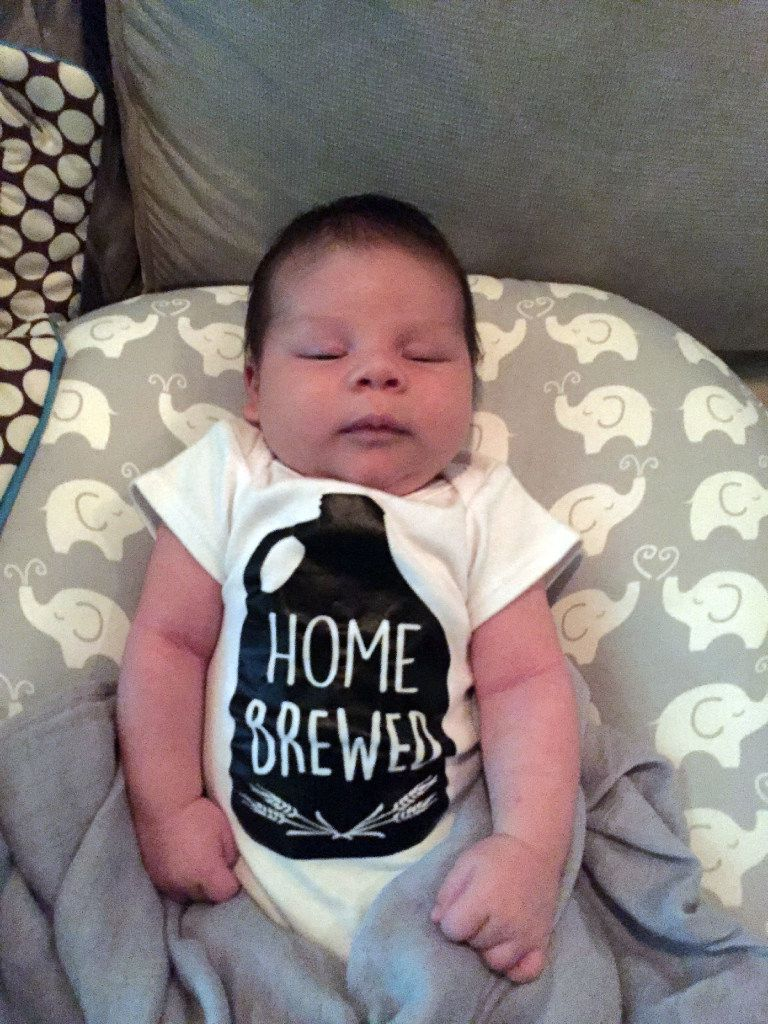 For Beer Week story. Three and a half week old Bash, son of Dallas CPA Guy Mitchell, wears a beer onesie. On November 25th, he'll be 4 months old.
