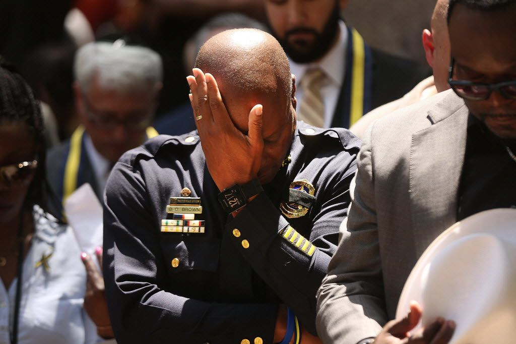 Dallas Police Chief David Brown bows his head Friday in prayer at a vigil for the deaths of five police officers slain during a Black Live Matter march. (Photo by Spencer Platt/Getty Images)