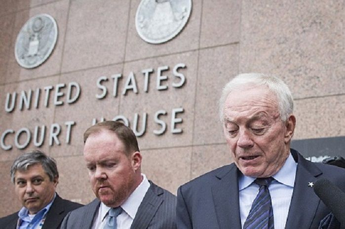 Levi McCathern (middle) with Dallas Cowboys owner Jerry Jones (on right) in front of the federal courthouse in downtown Dallas.