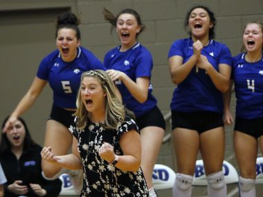 Trophy Club Byron Nelson coach Brianne Barker-Groth exults as Lady Bobcats players take to the air in celebration following the final point to give their 25-17, 25-17, 25-16 victory over Denton Guyer in the Class 6A Region I championship match Saturday at W.G. Thomas Coliseum. Byron Nelson advanced to the UIL state tournament with the win. (Steve Hamm/ Special Contributor)