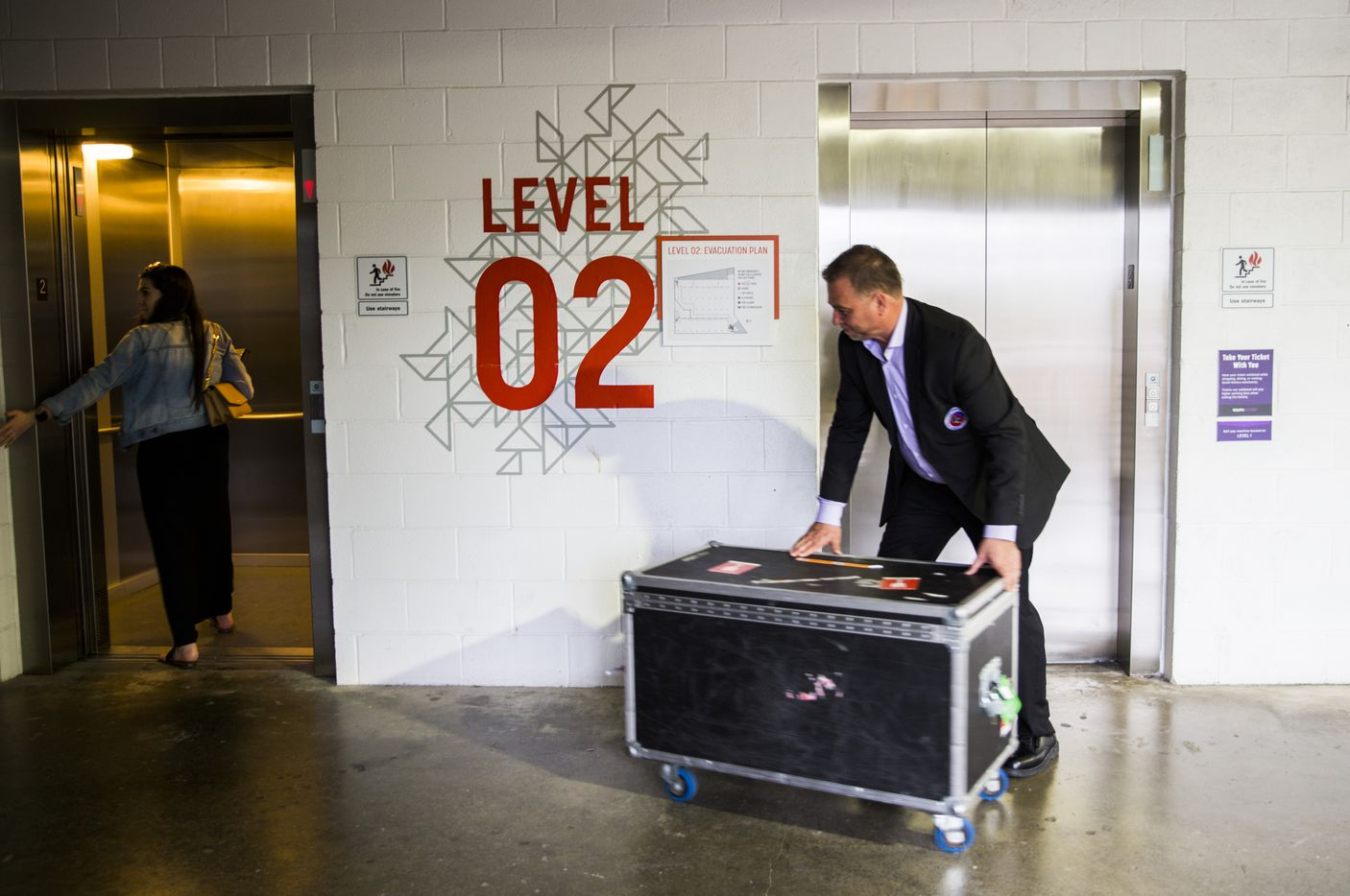Stanley Cup keeper Howie Borrow and Lauren Montgomery of Allied Global Marketing wheel a box containing the Stanley Cup to a location outside American Airlines Center before Game 6 of the Stars-Predators series.