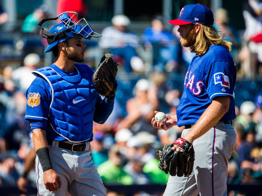 Texas Rangers catcher A.J. Jimenez (79) talks to starting pitcher A.J. Griffin (64) on the pitcher's mound during the fourth inning of a spring training game against the Seattle Mariners on Sunday, March 5, 2017 at the Peoria Sports Complex in Peoria, Arizona. (Ashley Landis/The Dallas Morning News)