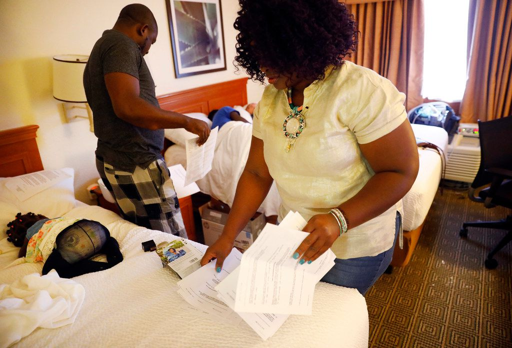 Linda Badawo of Mesquite, Texas (right) quickly sorts through printed out documents she plans on going to members of the House Committee on Human Services during her meeting with them. Linda, who drove to Austin in the early morning, stopped and bought a printer so she could print out the material, Wednesday, June 20, 2018.