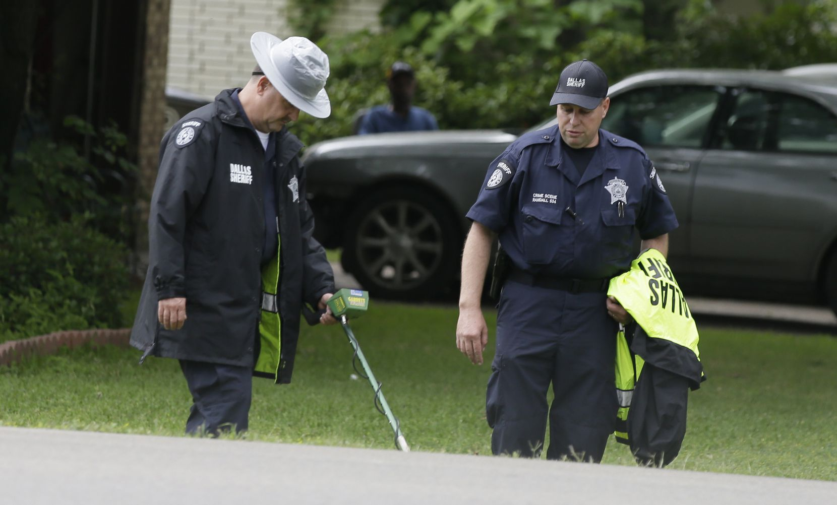 Dallas County Sheriff crime scene investigators use a metal detector at the intersection near where Jordan Edwards was killed by a police officer in Balch Springs, Texas, Wednesday, May 3, 2017.