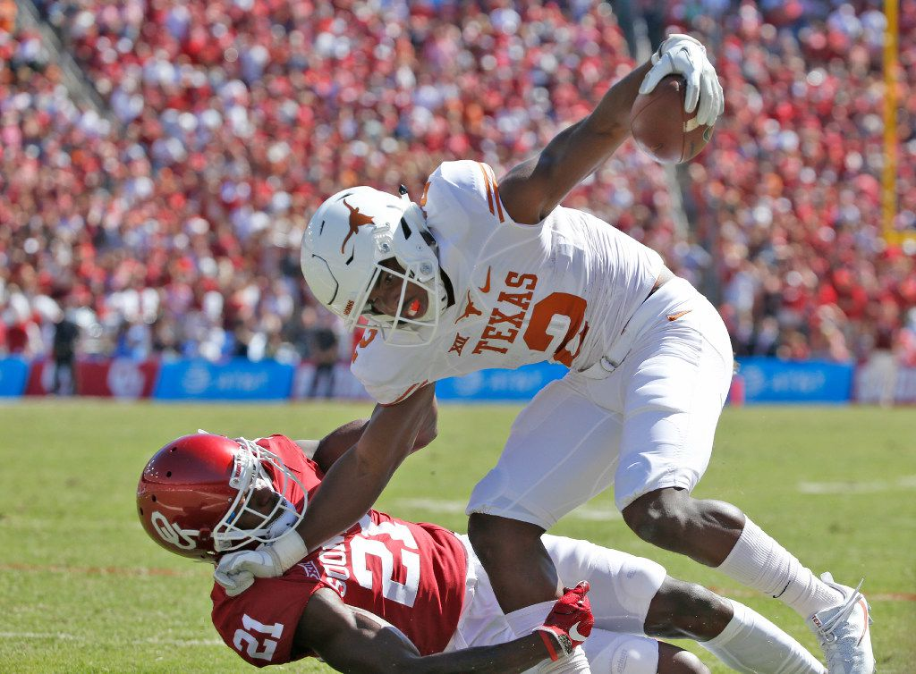 Texas Longhorns wide receiver Devin Duvernay (2) pushes Oklahoma Sooners safety Will Sunderland (21) in the first half of the Red River Showdown at the Cotton Bowl in Dallas, TX Oct. 8, 2016.   (Nathan Hunsinger/The Dallas Morning News)