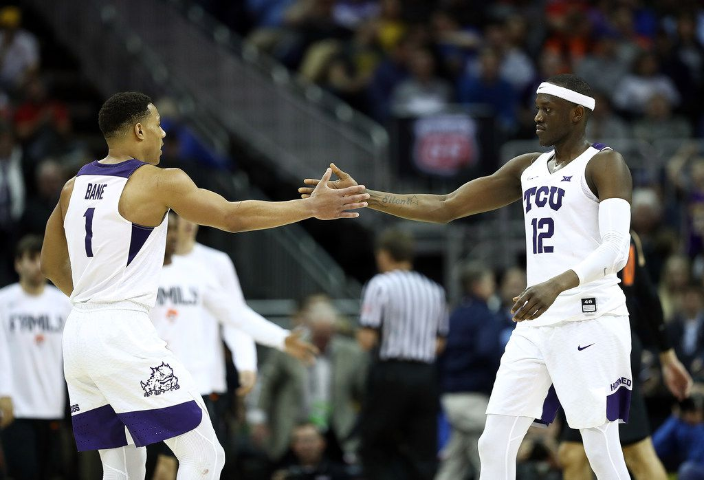 KANSAS CITY, MISSOURI - MARCH 13:  Desmond Bane #1 of the TCU Horned Frogs celebrates with Kouat Noi #12 as the Horned Frogs defeat the Oklahoma State Cowboys during the first round game of the Big 12 Basketball Tournament at the Sprint Center on March 13, 2019 in Kansas City, Missouri. (Photo by Jamie Squire/Getty Images)