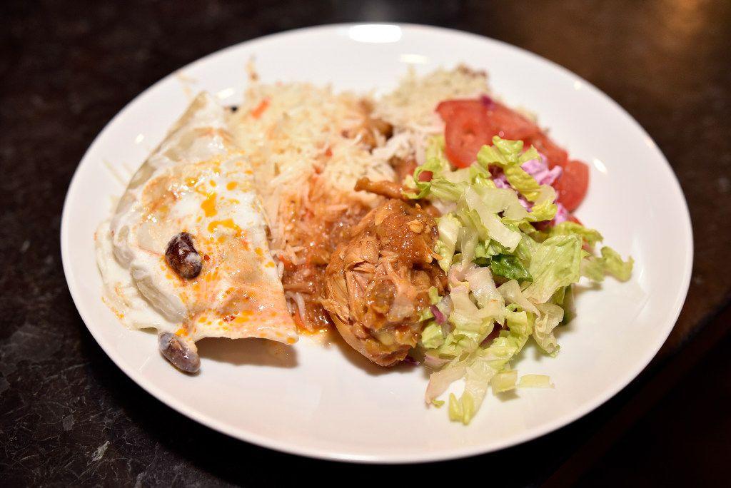 A dish of mantu (beef dumpling), rice, chicken korma and Afghan salad prepared by Jamileh Jafari for the Sunday Supper Series in Dallas.