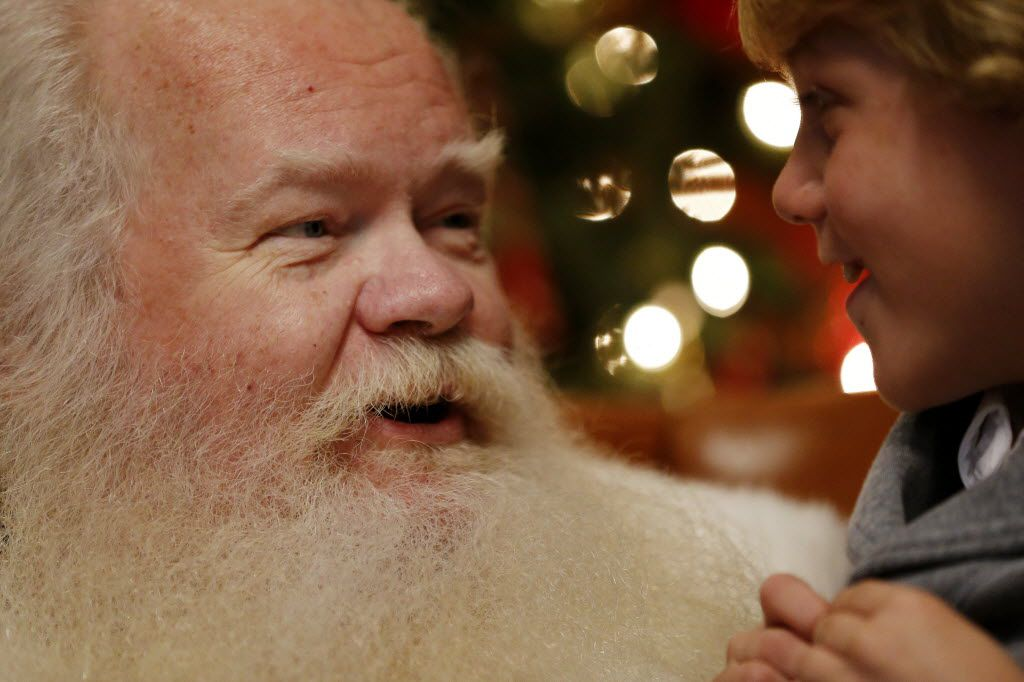 Santa Claus took a gift request from Roman Kister at NorthPark Center in Dallas.