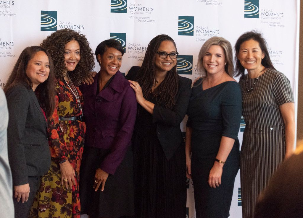 Michele Norris, second from left, former NPR host, and Director Ava DuVernay, fourth from left, pose for photos before the Dallas Women's Foundation 33rd annual luncheon at the Hilton Anatole Hotel on Wednesday, Nov. 7, 2018.  (Rex C Curry/Special Contributor)