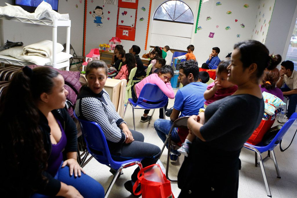 Children and parents wait at the Humanitarian Respite Center in McAllen, Texas, on June 10, 2018.