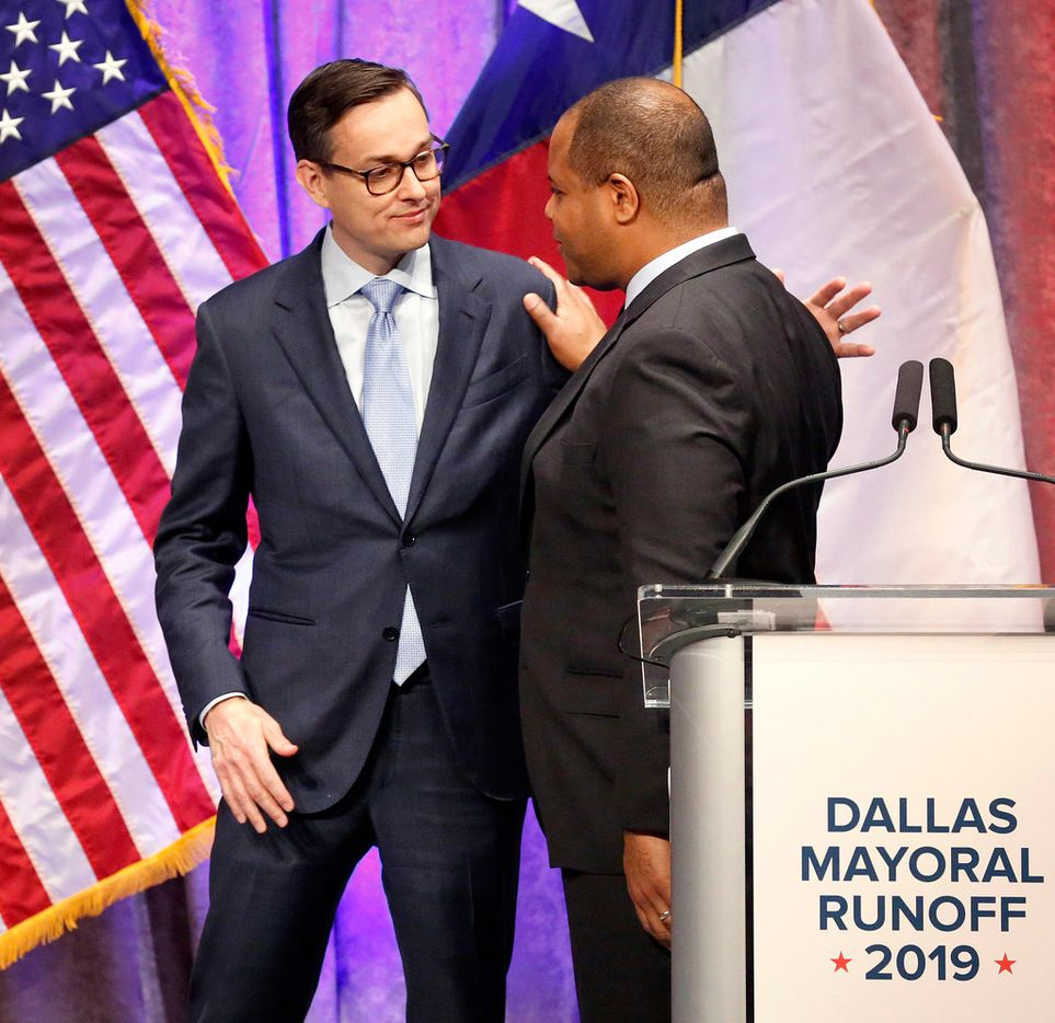 Dallas City Council member Scott Griggs (left) and State Rep. Eric Johnson, D-Dallas, shake hands and visit following their televised one-hour debate sponsored by The Dallas Morning News, NBC5 and the Dallas Regional Chamber at El Centro College in downtown Dallas, Tuesday, May 14, 2019.  The two candidates are in a runoff election to become Dallas Mayor. (Tom Fox/The Dallas Morning News)