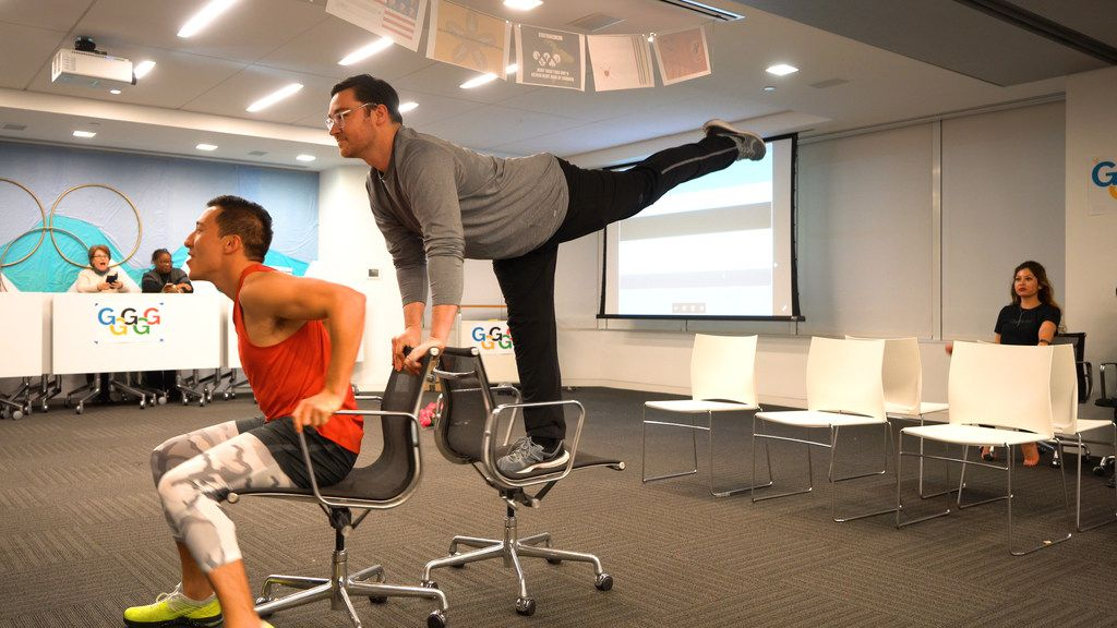 Gensler emplolyees Richard Lucio and Joshua Metzger glide on rolling office chairs at the ice skating competition the company's Winter Games. Other office-friendly games included cross country skiing (using shipping boxes as skis), hockey, dodgeball and team bobsled (using rolling office chairs).