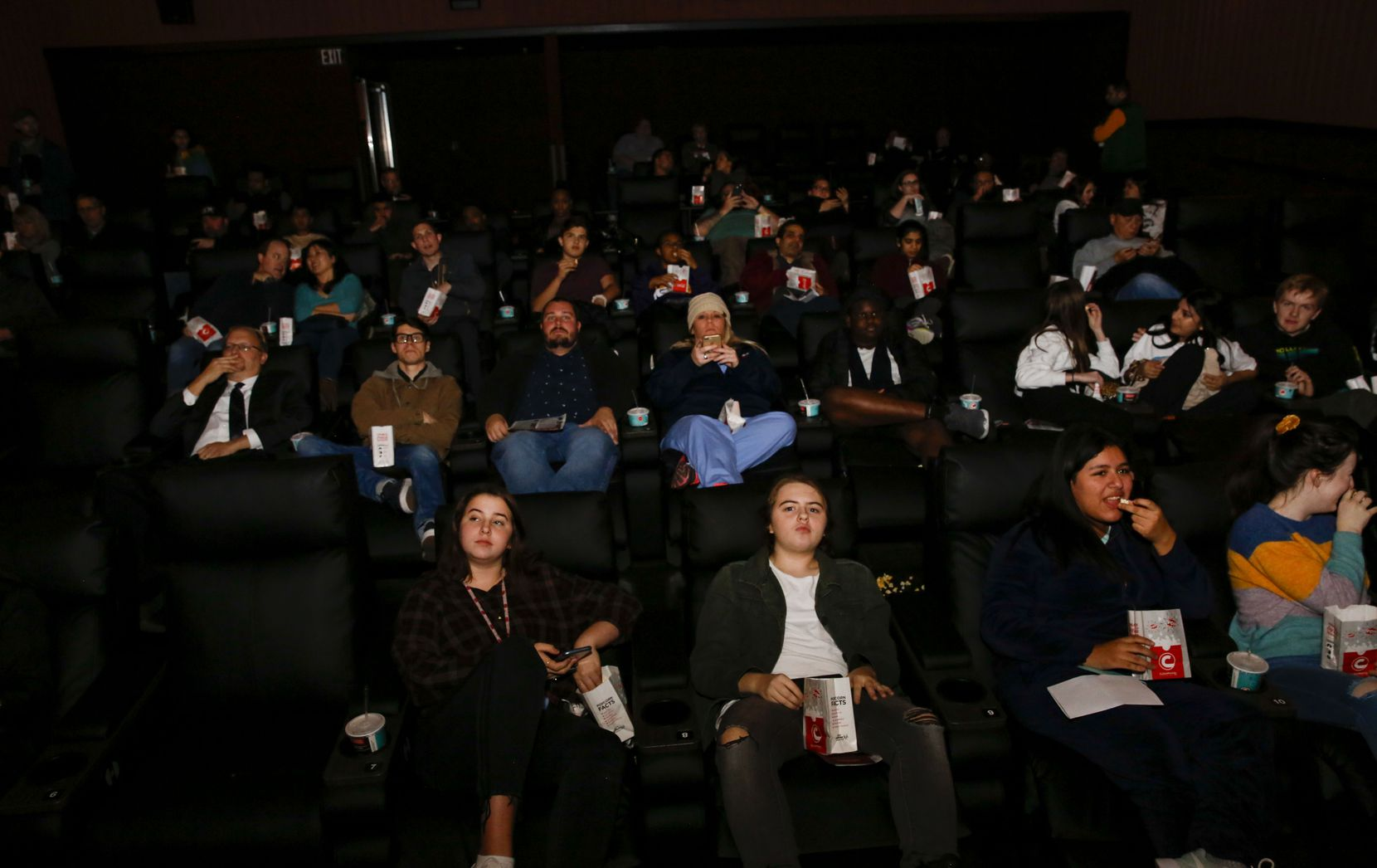 """Guests check out the newly remodeled Cinemark theater in Plano. The longtime """"dollar theater"""" was re-built with reclining chairs and upgraded snack and drink options."""