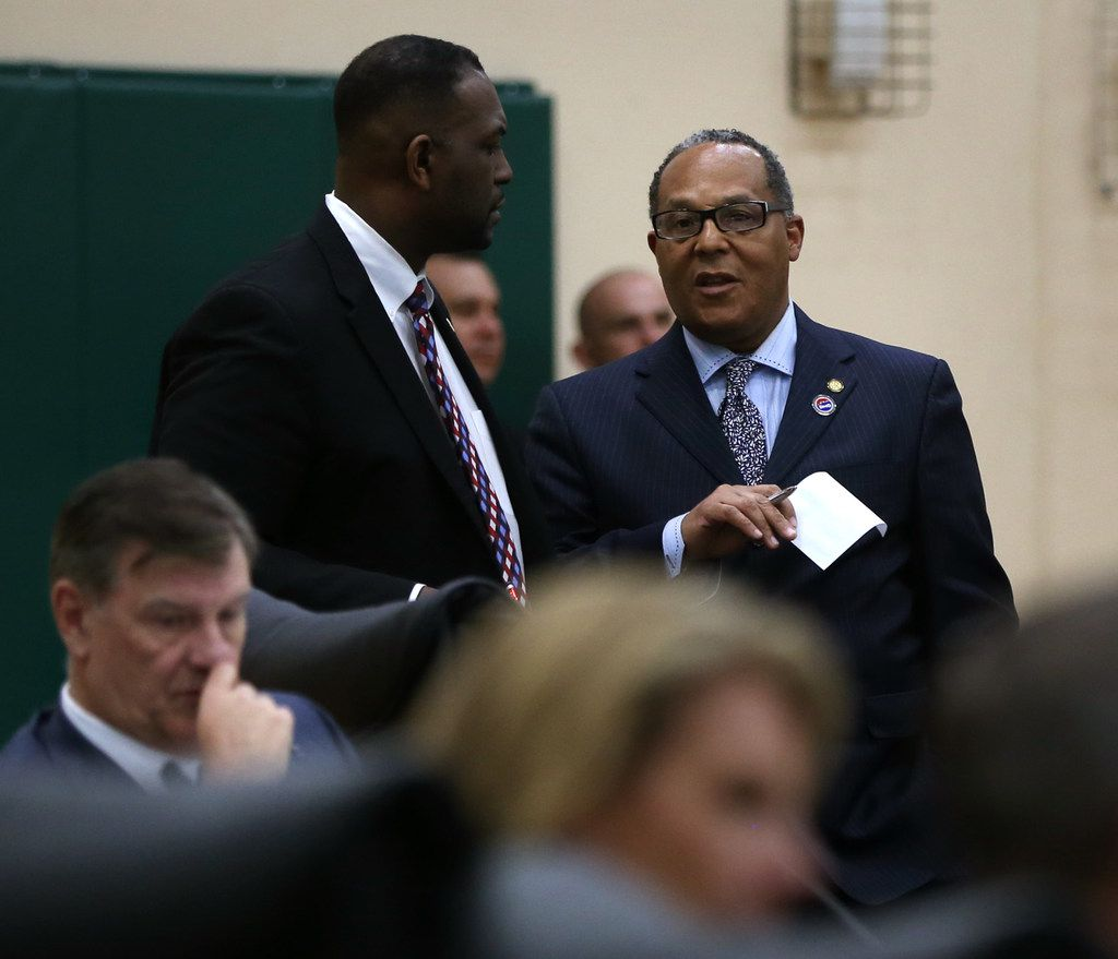 Dallas City Council member Kevin Felder (right) speaks with Dallas Mayor Pro Tem Casey Thomas II during a City Council meeting at Park in the Woods Recreation Center in Dallas on Feb. 13, 2019. Dallas police are investigating allegations that Felder was involved in a car accident with someone riding a motorized scooter near Fair Park. (Rose Baca/Staff Photographer)
