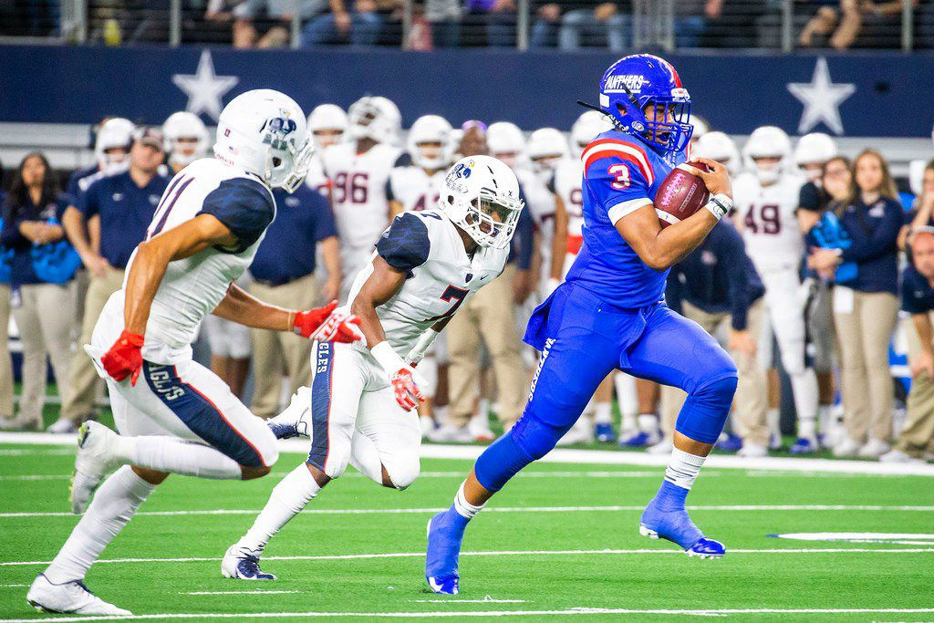 Duncanville quarterback Ja'Quinden Jackson (3) races past Allen defensive backs KJ Willie (11) and Devyn Butler (7) as he goes 40 yards for a touchdown to break a 35-35 tie in the fourth quarter of a Class 6A Division I state semifinal at AT&T Stadium on Dec. 15, 2018. (Smiley N. Pool/The Dallas Morning News)