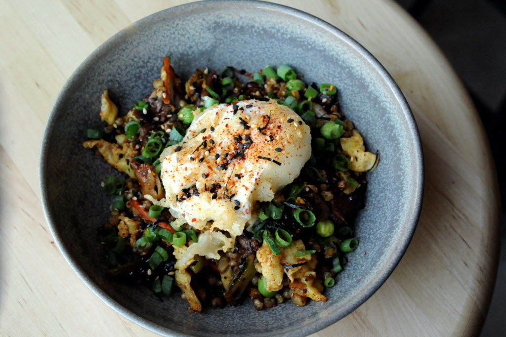 Fried sorghum with oyster mushrooms, Napa cabbage, spring peas, tempura farm egg, and furikake at Rapscallion