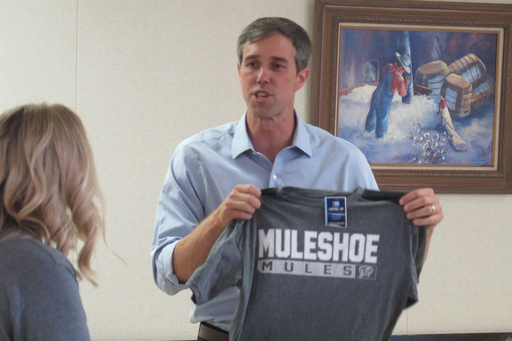 Rep. Beto O'Rourke campaigns in Muleshoe, Texas, on July 31, 2018. Hosts gave him Muleshoe swag, including locally made corn chips and a Muleshoe T-shirt.